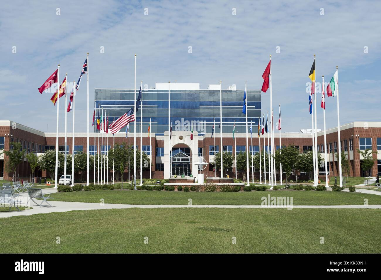 The American flag flies at half-staff outside the NATO headquarters building at Camp Allen in remembrance of the - Stock Image