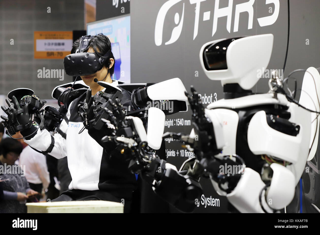 Tokyo, Japan. 29th Nov, 2017. Japan's automobile giant Toyota Motor unveils the new humanoid robot 'T-HR3' - Stock Image