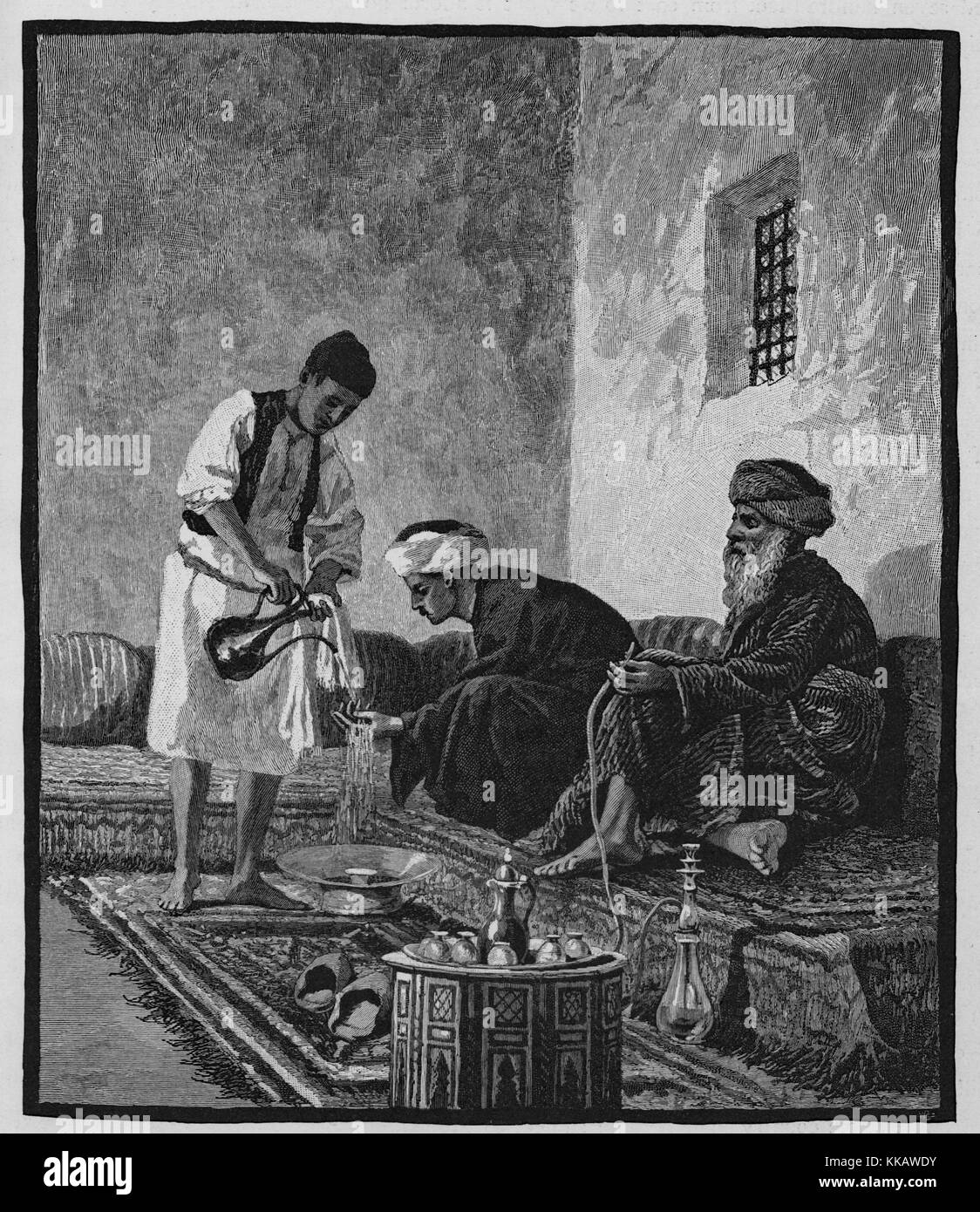 An engraving showing the ritual washing of hands after eating a meal known as ablution, a man using a container - Stock Image
