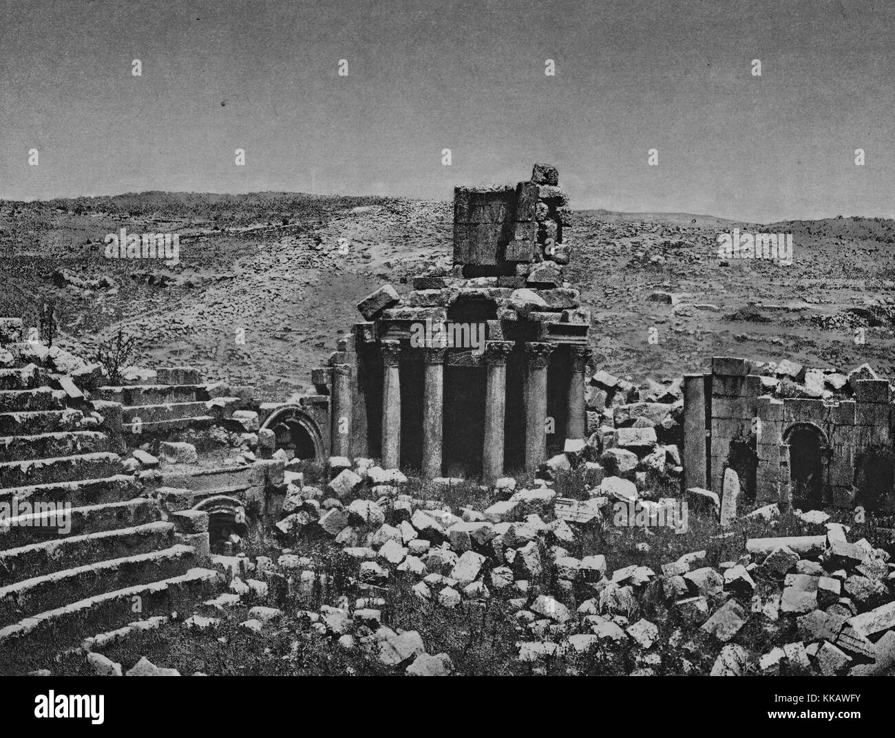 The ruins of the Roman portion of the city of Jerash, partial structures and columns are standing while large blocks - Stock Image