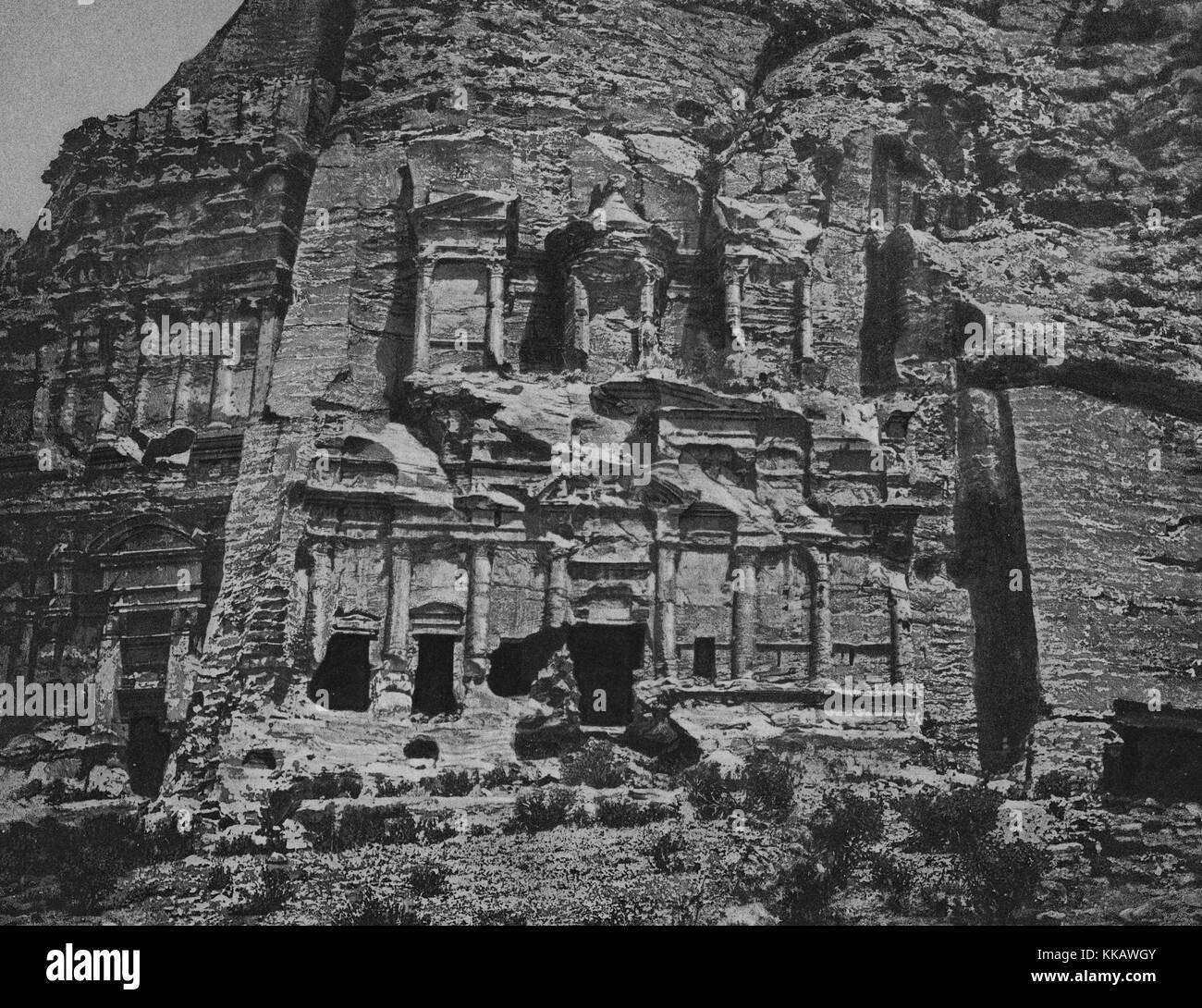The rock-cut architecture in the ancient city of Petra, this section part of a series of tombs in the southern part - Stock Image