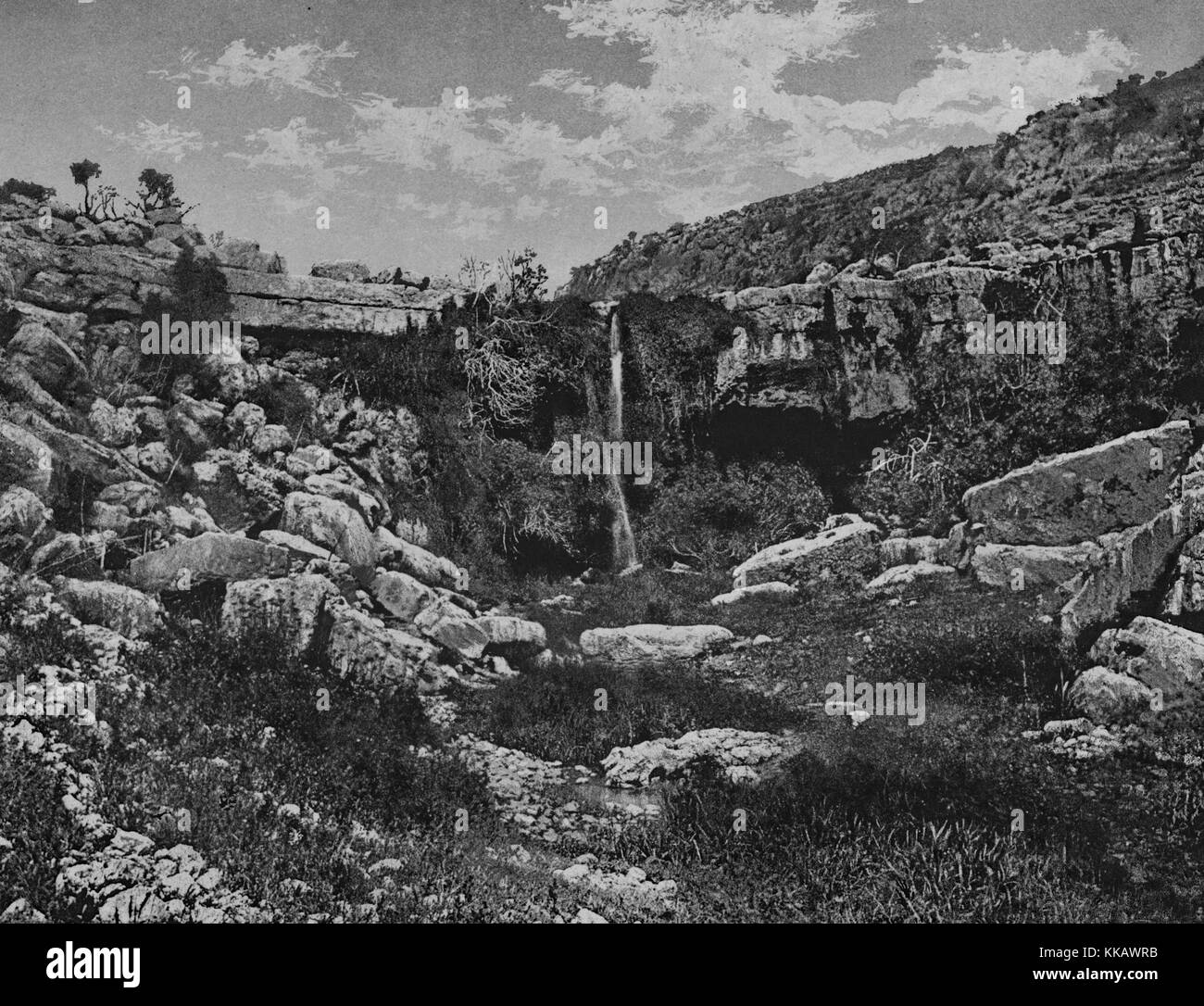 A photograph of Ain Mousa at the base of Mount Nebo, it is the supposed site where Moses struck water for his followers, - Stock Image