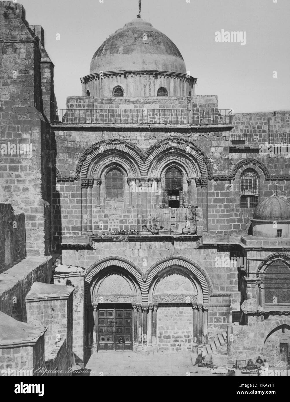 A photograph of the entrance to the Church of the Holy Sepulchre, the building is a stone work structure that has - Stock Image
