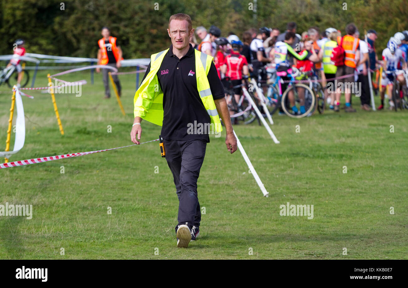 Cyclocross race official looking concerned - Stock Image
