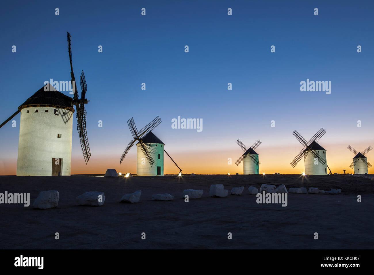 Illuminated traditional windmills at rising, Campo de Criptana, Spain - Stock Image