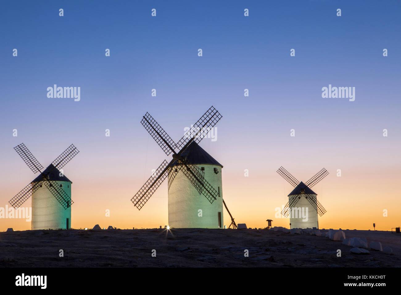 Illuminaed traditional windmills at rising, Campo de Criptana, Spain - Stock Image