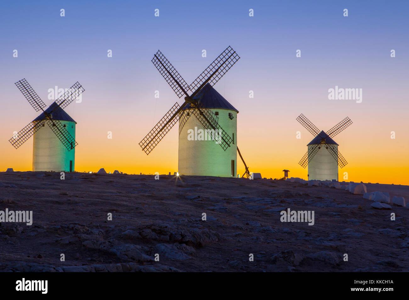 Illumintaed traditional windmills at rising, Campo de Criptana, Spain - Stock Image