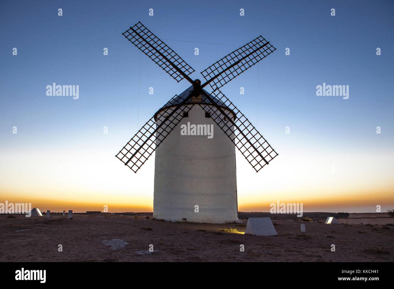 Illuminated traditional windmill at rising, Campo de Criptana, Spain - Stock Image