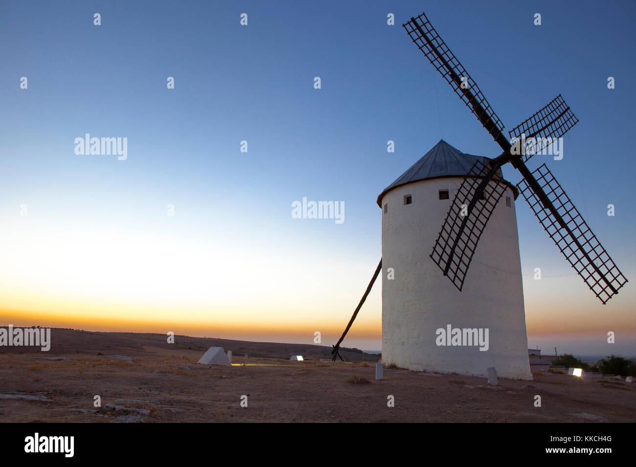 Illuminaed traditional windmill at rising, Campo de Criptana, Spain - Stock Image