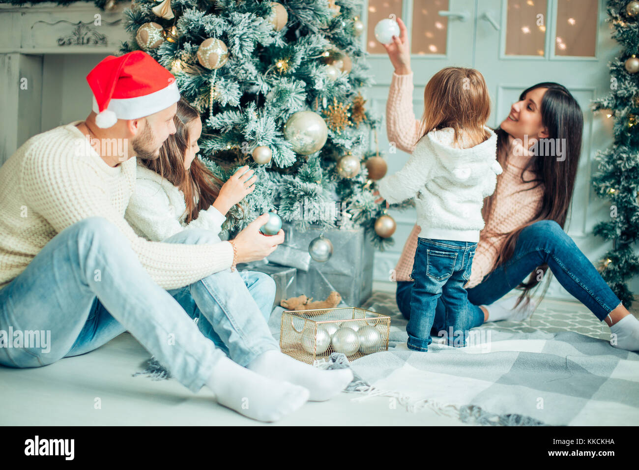 happy girl decorating Christmas tree.Family, christmas, ,happiness concept - Stock Image