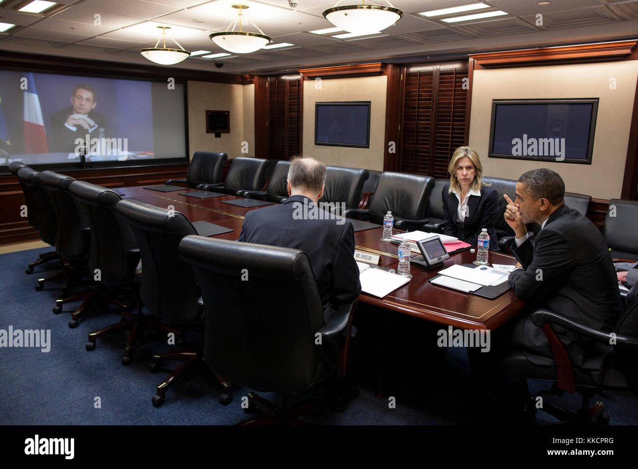 President Barack Obama participates in a video teleconference with President Nicolas Sarkozy of France, in the Situation - Stock Image