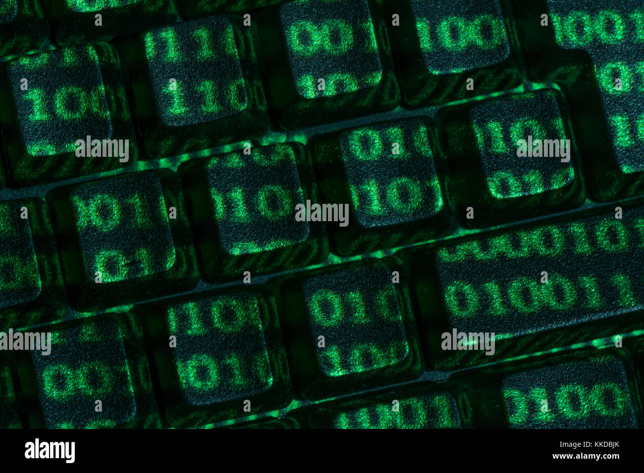 Plain black Qwerty keyboardetc. keys with green Binary 0's and 1's projected on surface. Potential metaphor - Stock Image