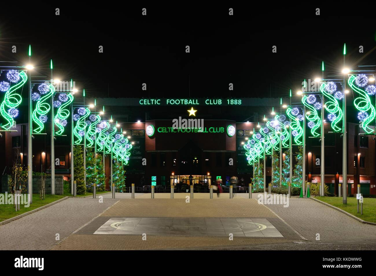 The Celtic Way adorned with festive christmas lights leading up to Celtic Park football stadium at night in Glasgow, Stock Photo
