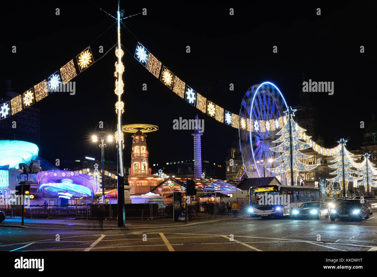 Glasgow, George Square Christmas lights and fairground attractions Stock Photo
