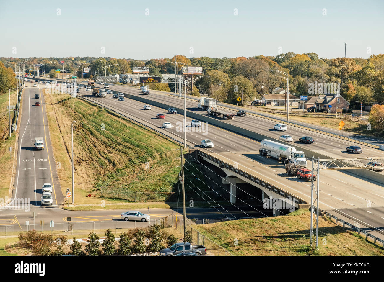 Interstate 85 with midday traffic driving through Montgomery Alabama USA, with a long exit ramp and a surface street - Stock Image