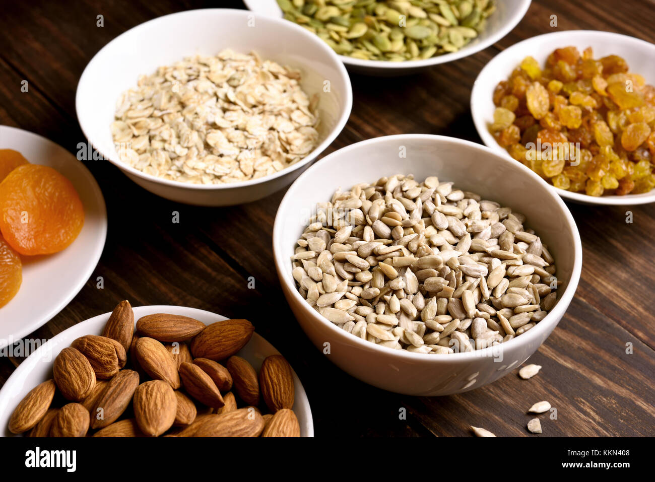 Healthy breakfast with nuts, seeds and dried fruits. Concept of natural organic food - Stock Image