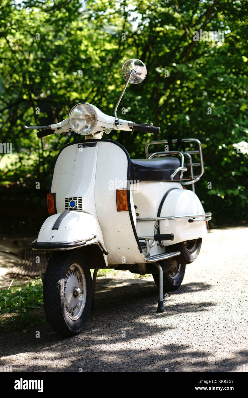 Front and side view of an old nostalgic  motorcycle, scooter. - Stock Image