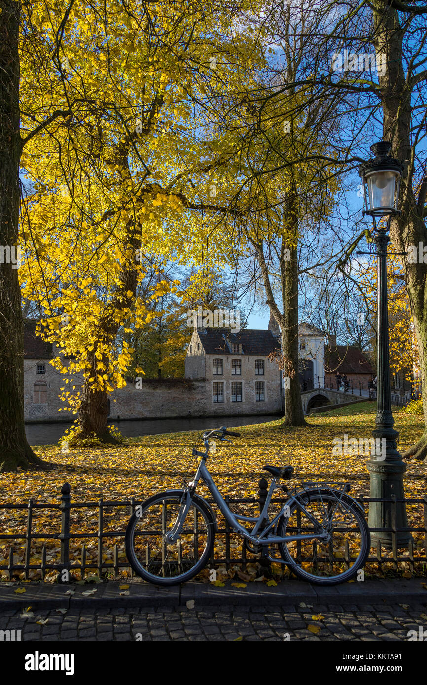 Bruges in Belgium. Autumn view towards the Beguine Covent and Begijnhof Bridge. - Stock Image