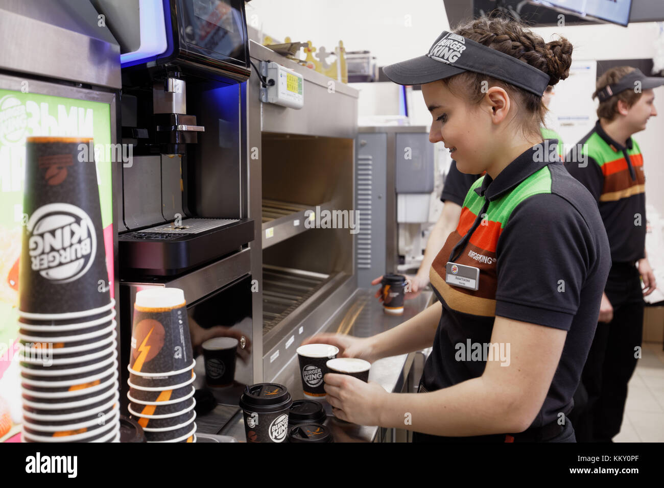 Staff of 500th Burger King restaurant in Russia preparing coffee in the day of opening - Stock Image