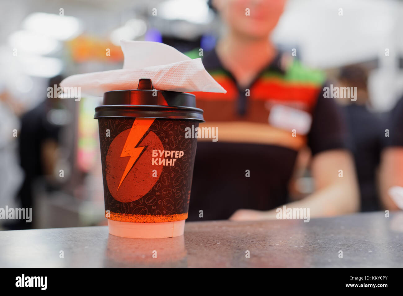 Cup of coffee on the service desk of Burger King restaurant - Stock Image
