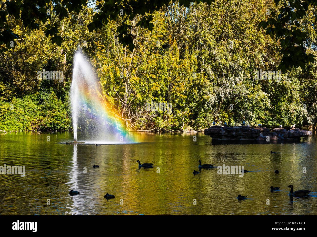 Fountain and rainbow in St James's Park, London, UK - Stock Image