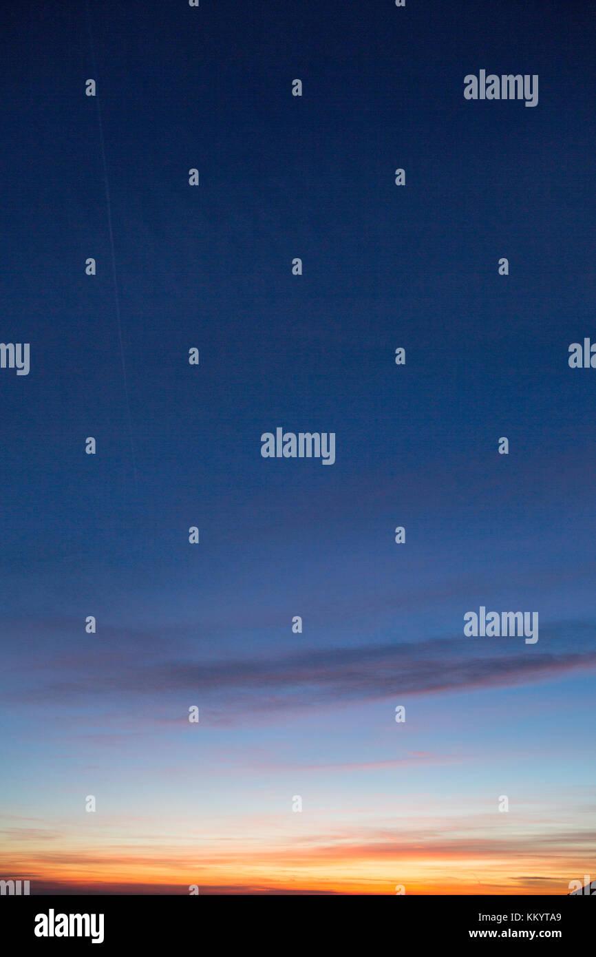 Dark blue sky overlay background with orange sunset - Stock Image