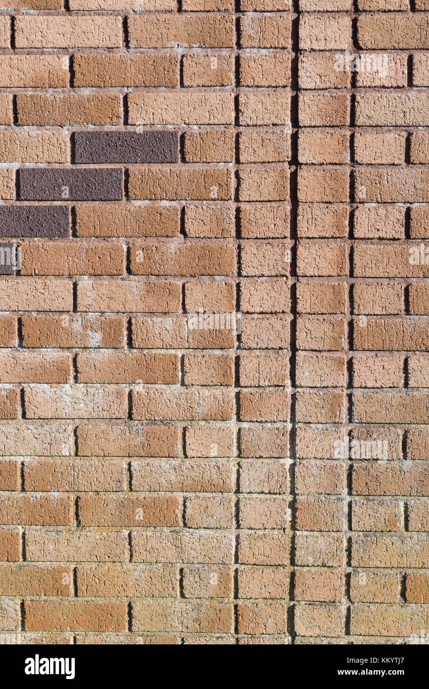 Red brick patterns and lines in bright sunshine - as abstract or photographic background / backdrop. - Stock Image