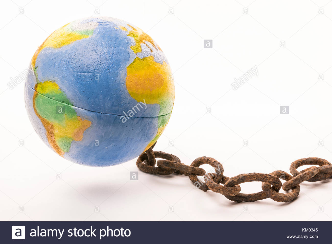 A world map attached to the ground with a chain rusty on white background - Stock Image