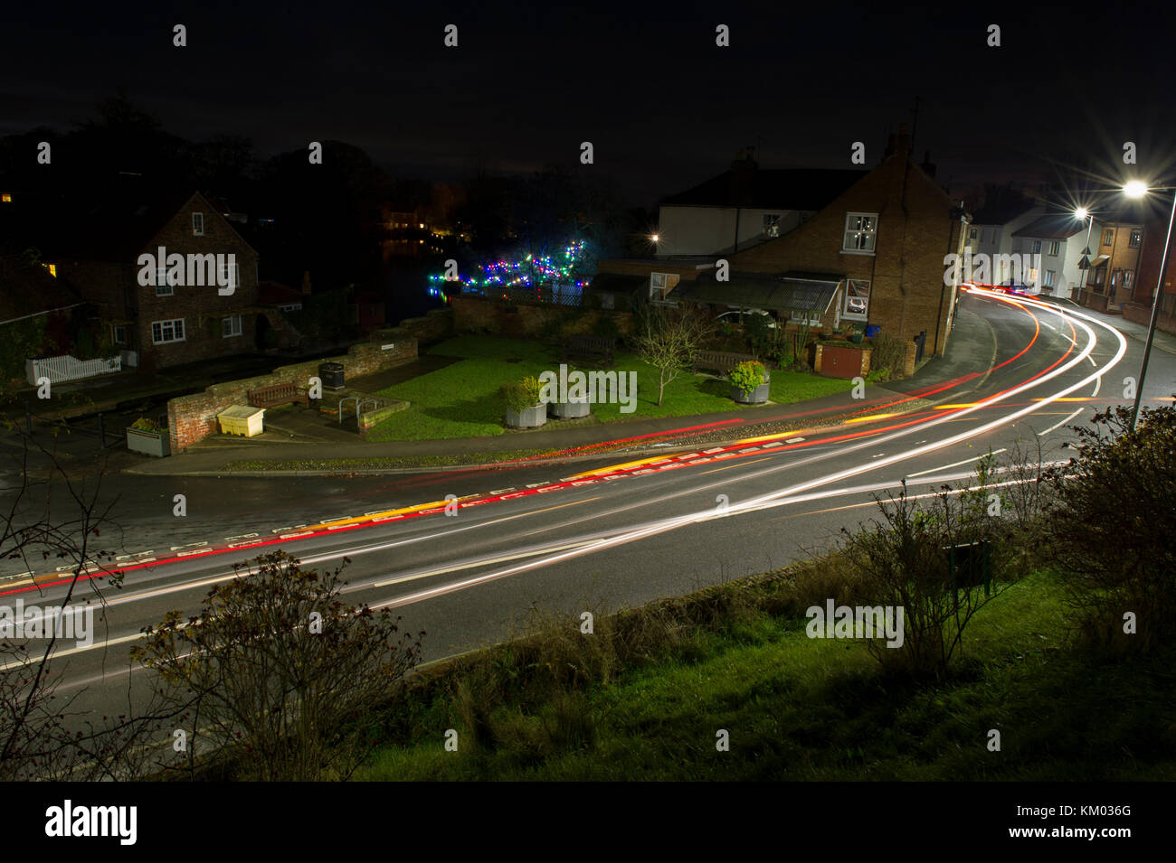 Light trails from cars passing through the village of Nafferton in East Yorkshire - Stock Image