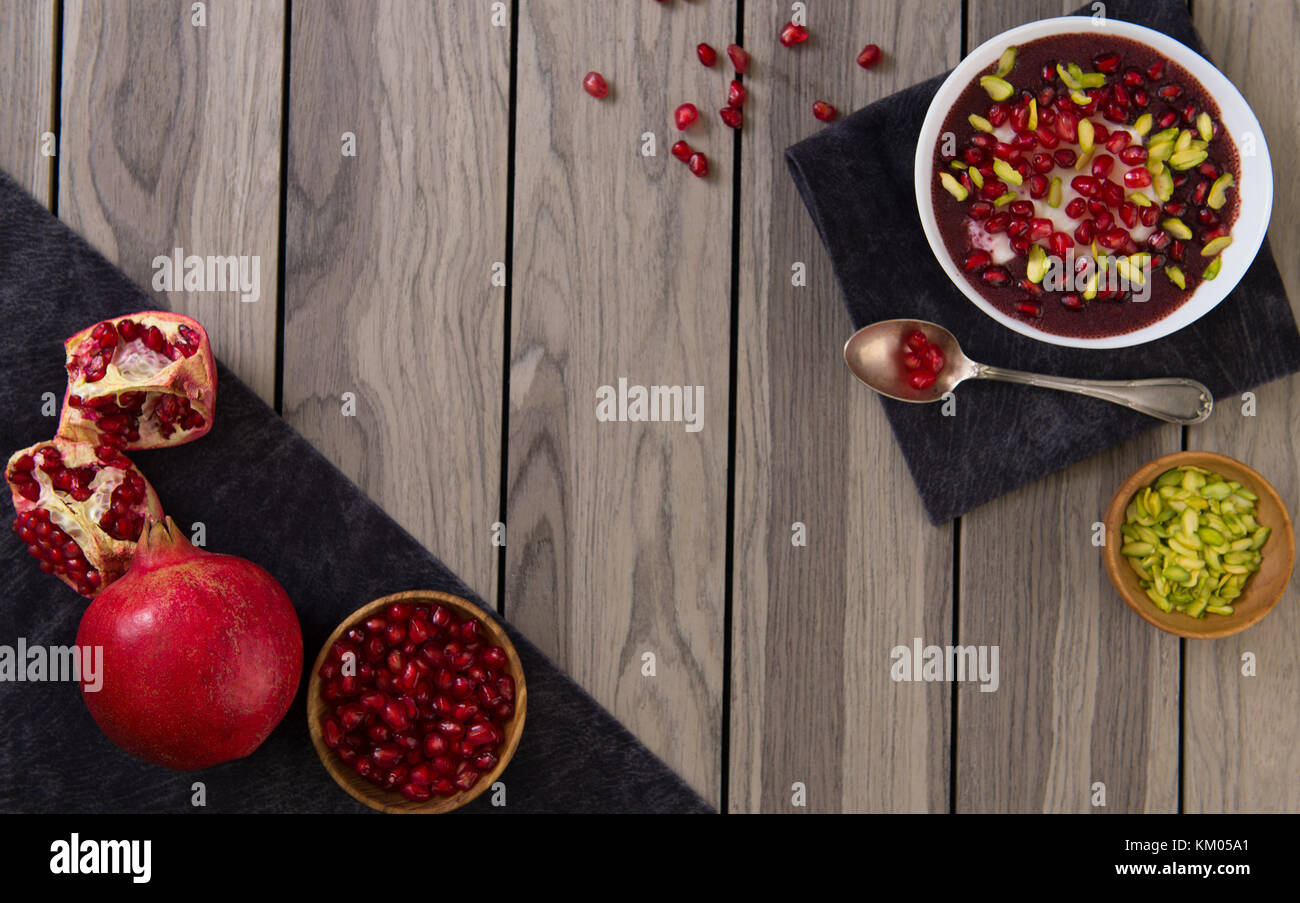 Pomegranate desert with Chia Seed, tapioca pudding and Yogurt. healthy eating. top view. copy space. - Stock Image
