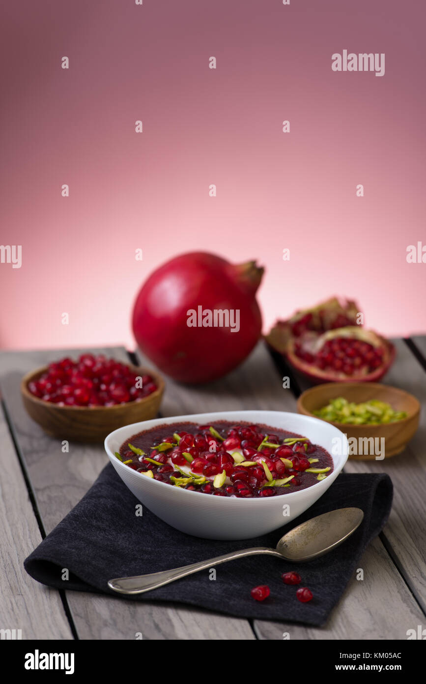 Pomegranate desert with pistachios, Chia Seed, tapioca pudding and Yogurt. healthy eating. pink copy space. - Stock Image
