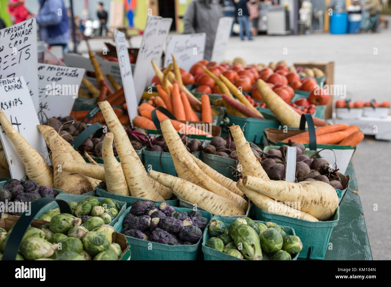 Produce including carrots, Parsnip,  table at a farmers market. - Stock Image