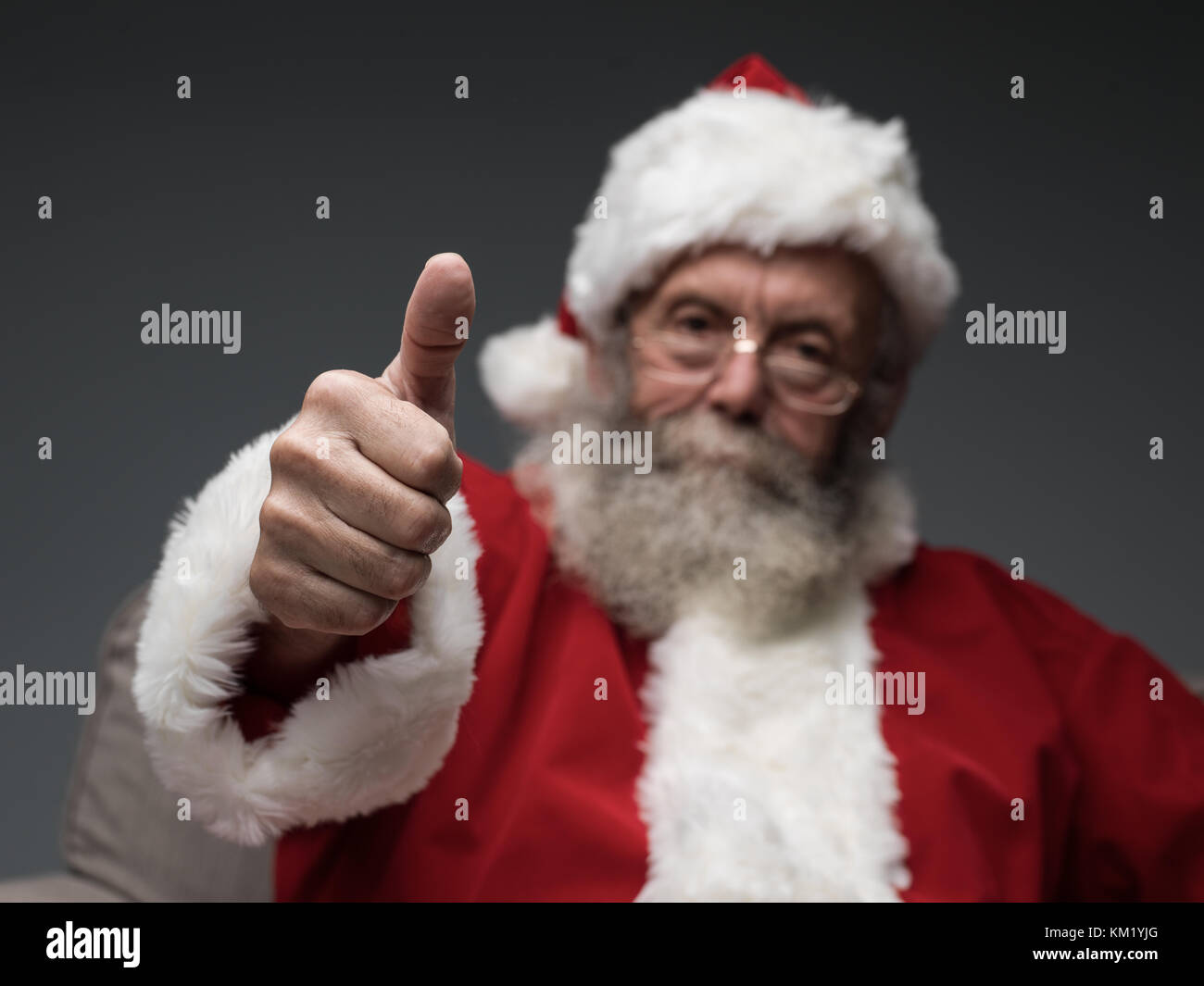 Cheerful Santa Claus giving a thumbs up, happiness and success concept - Stock Image
