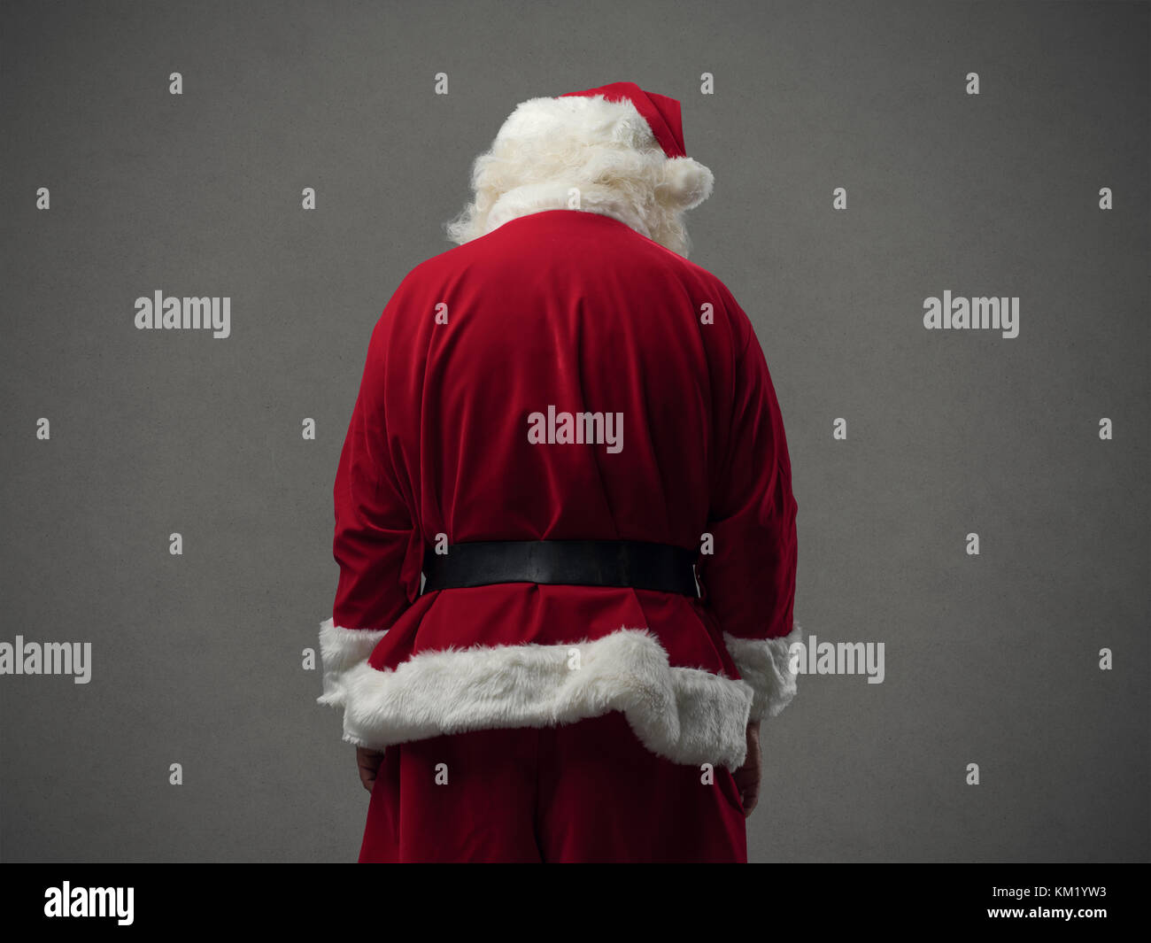 Sad Santa Claus looking down, back view, Christmas and celebrations concept - Stock Image