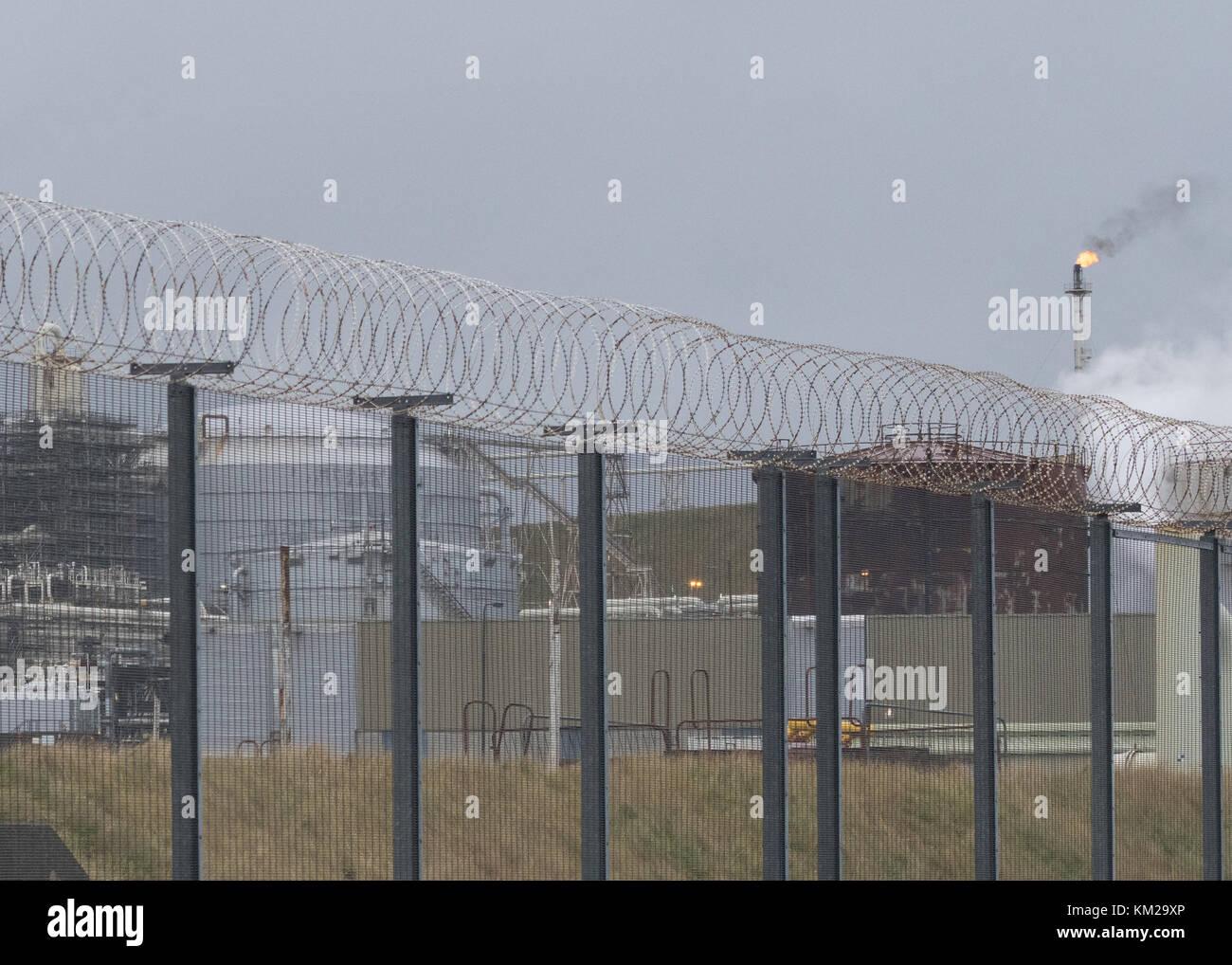 Razor-wire Security fencing at Sullom Voe Oil Terminal, Shetland Islands, Scotland, UK - Stock Image