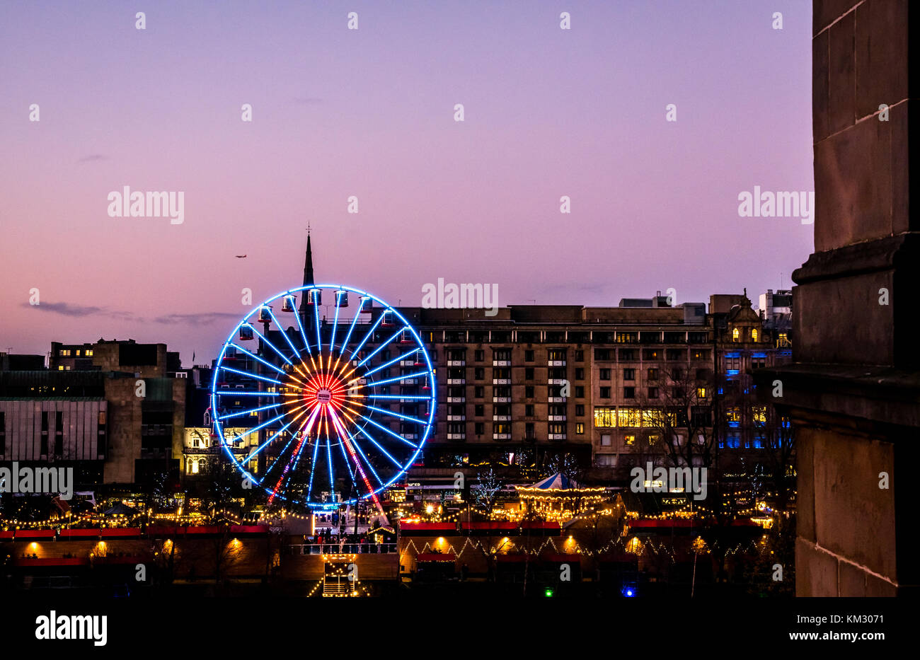 View across Princes Street Gardens to Forth 1 Big Wheel, with Bank of Scotland headquarters in foreground, celebrating - Stock Image