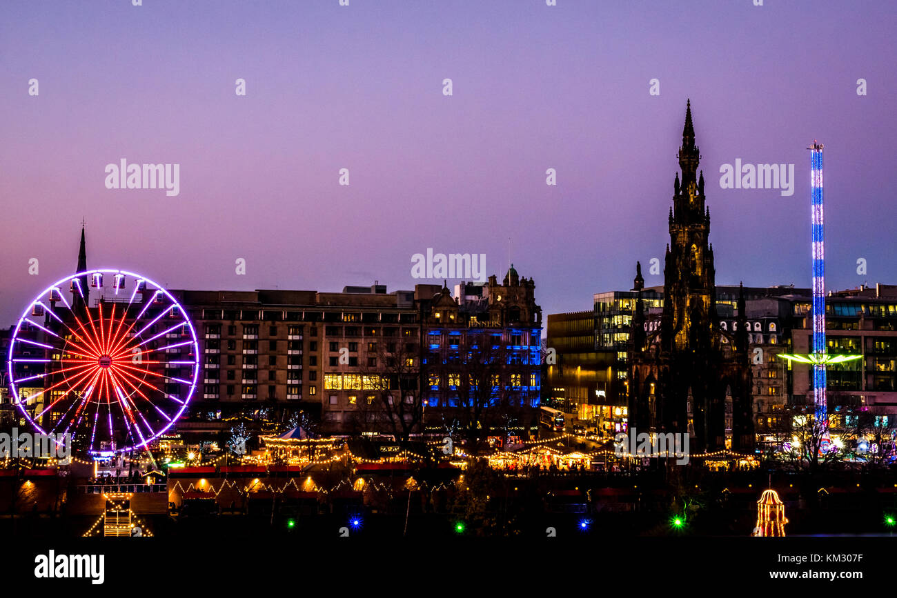View across Princes Street Gardens to Forth 1 Big Wheel, Scott Monument and Starflyer fairground ride, celebrating - Stock Image