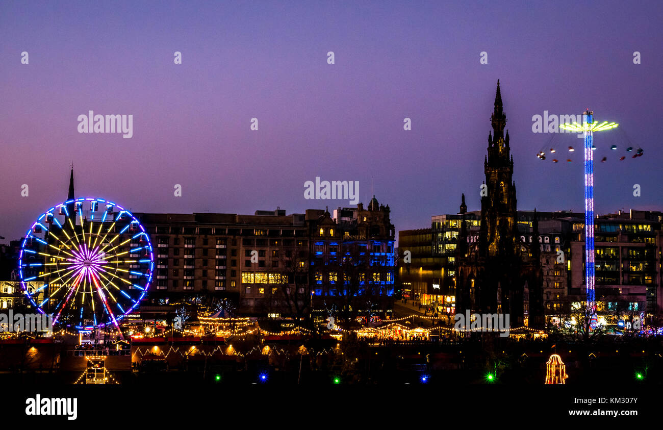 Viewo of  Princes Street Gardens to Forth 1 Big Wheel, Scott Monument and Star flyer fairground ride, celebrating - Stock Image