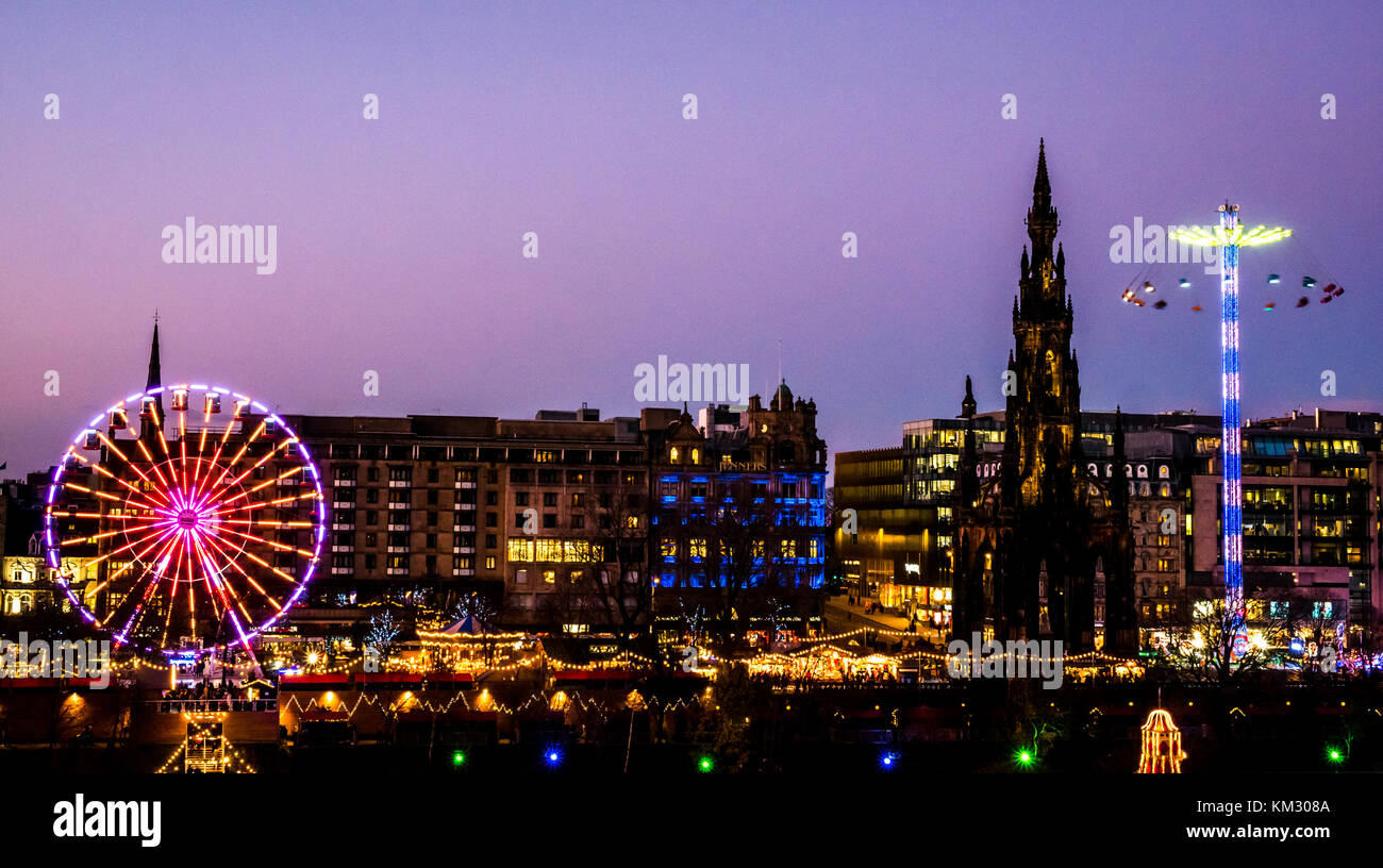 View of Princes Street Gardens to Forth 1 Big Wheel, Scott Monument and Star flyer fairground ride, celebrating - Stock Image