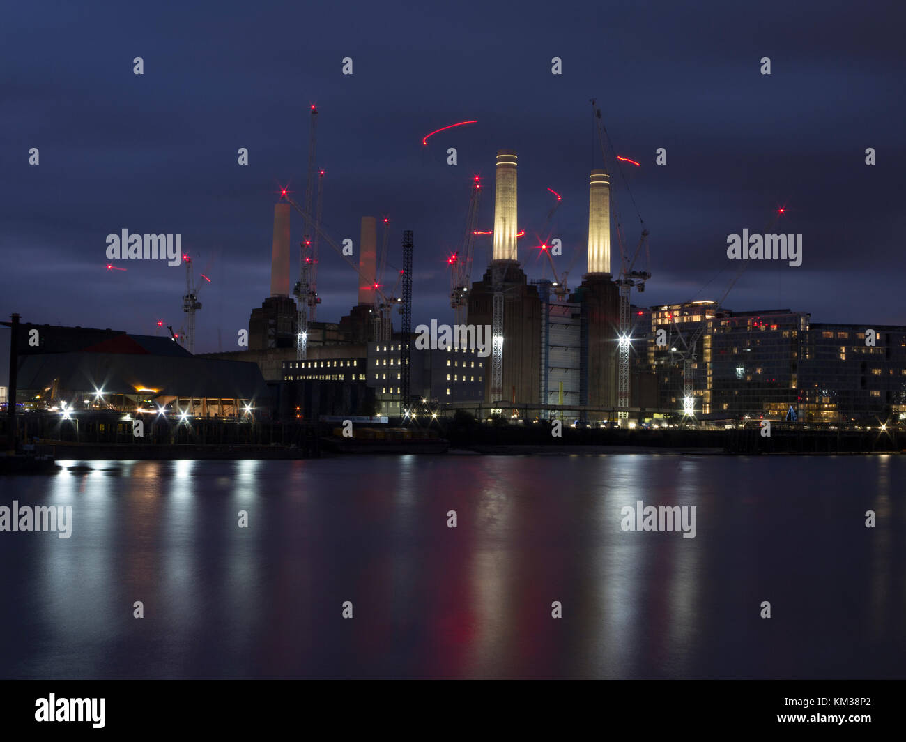 Battersea Power Station under redevelopment at night - all change from a few years ago when it was a brown field - Stock Image