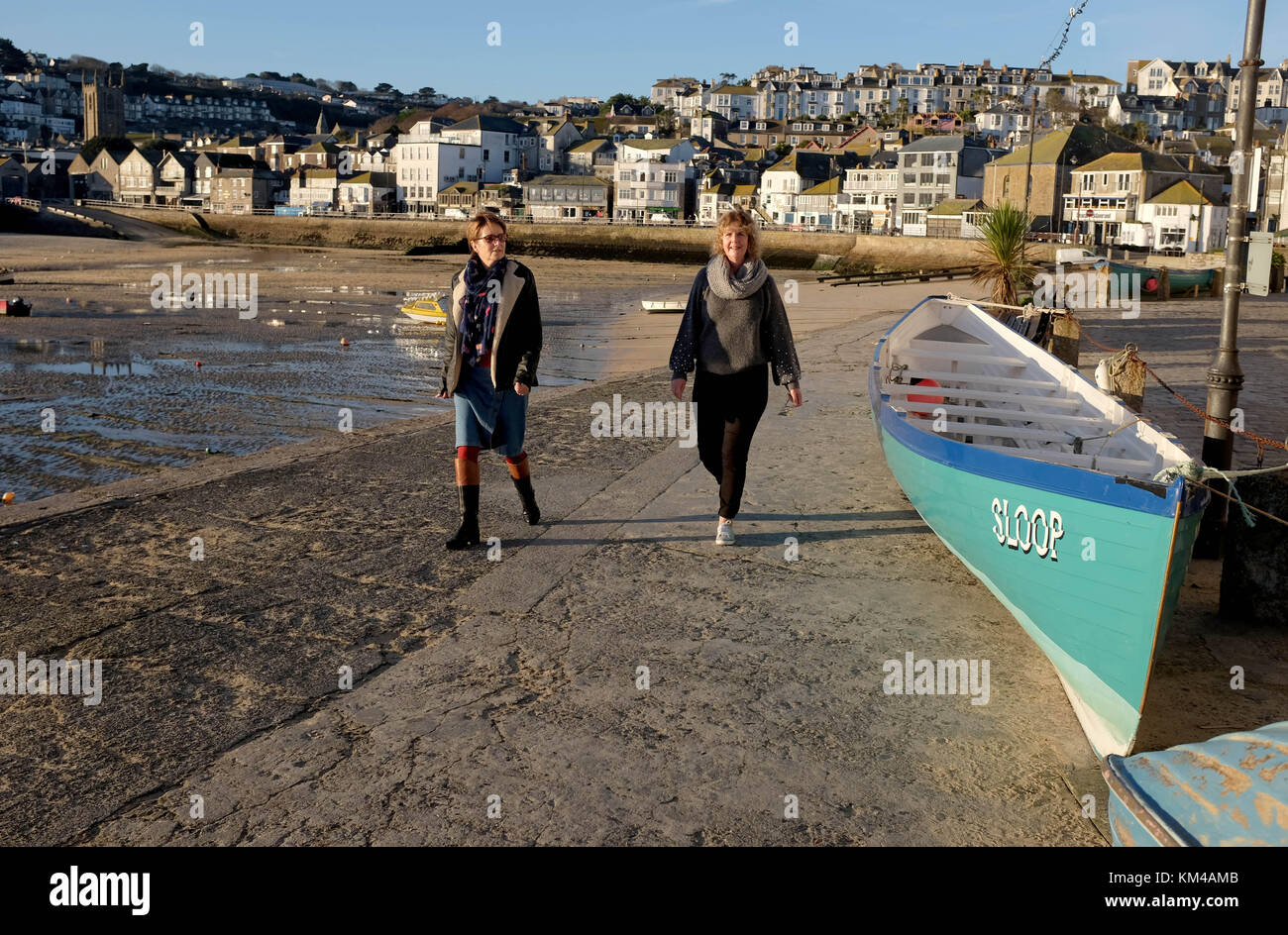 Cornish Gig rowing boat on the harbour at St Ives Cornwall UK - Stock Image