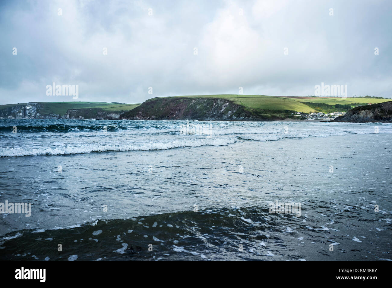 View of wave patterns in shallow choppy water, from the sea shore. Headland and coastline. - Stock Image