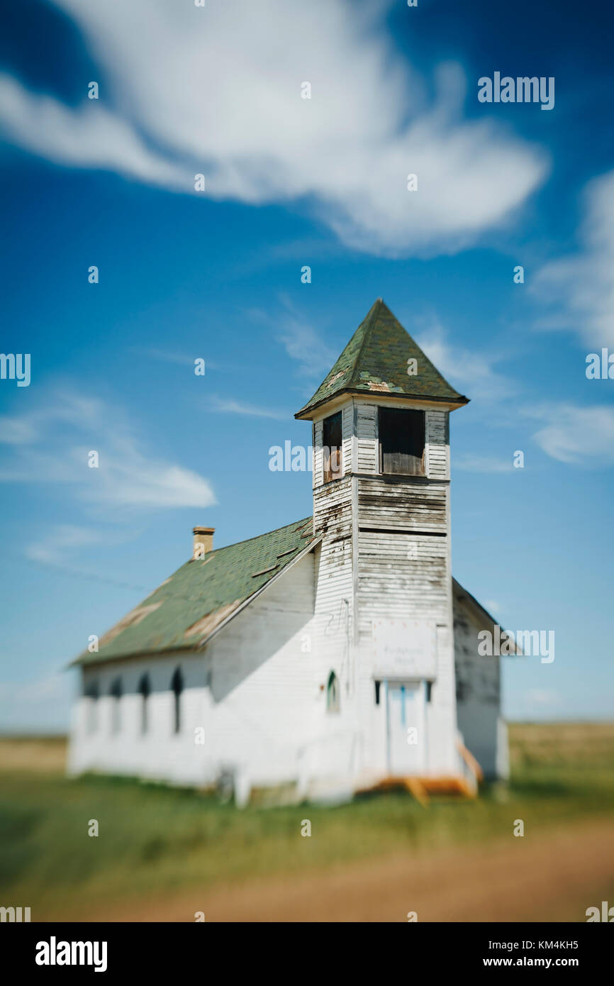 An abandoned church on the prairie - Stock Image