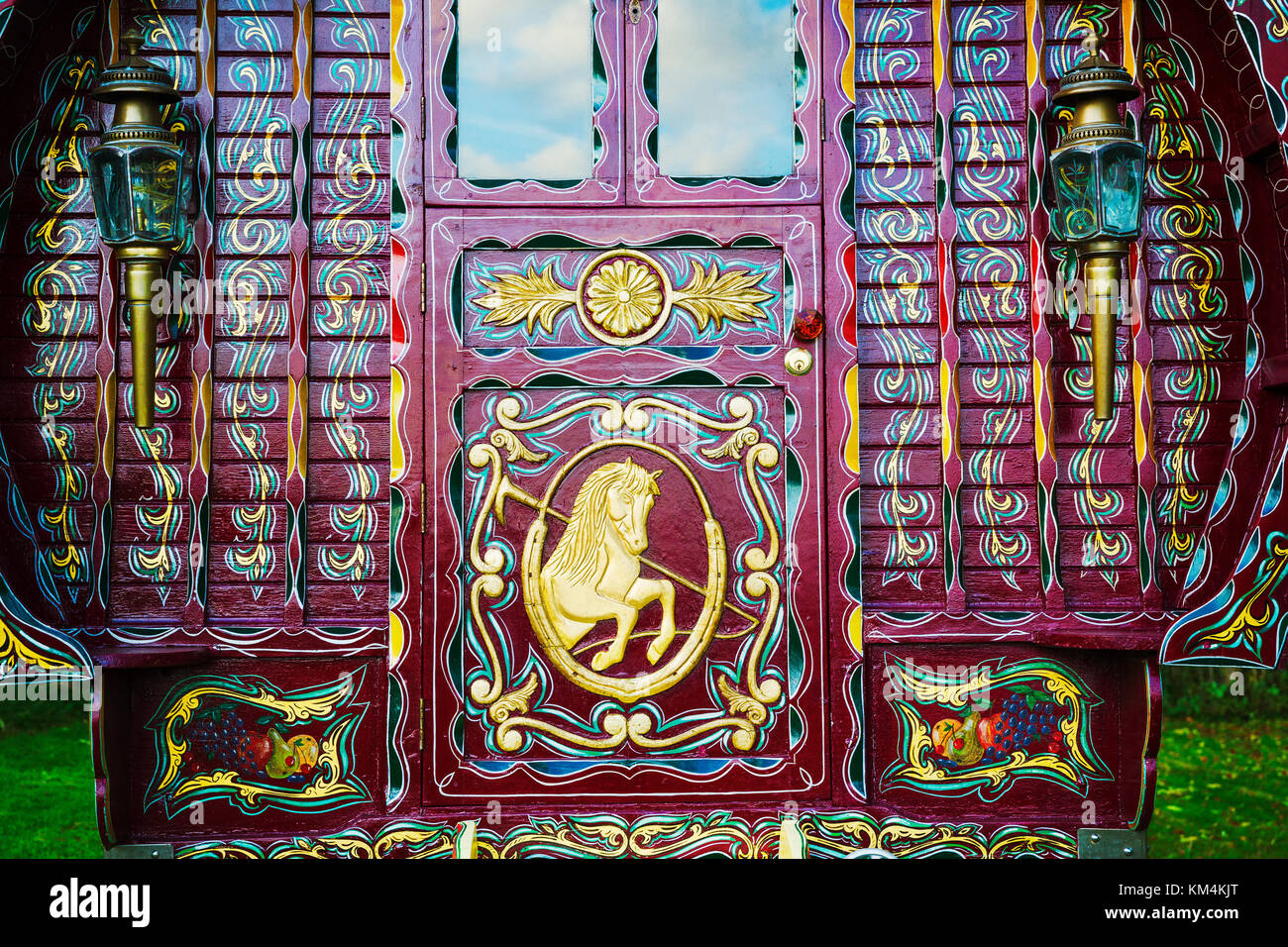 The rear of a traditionally decorated and painted gypsy caravan,  door and windows. - Stock Image