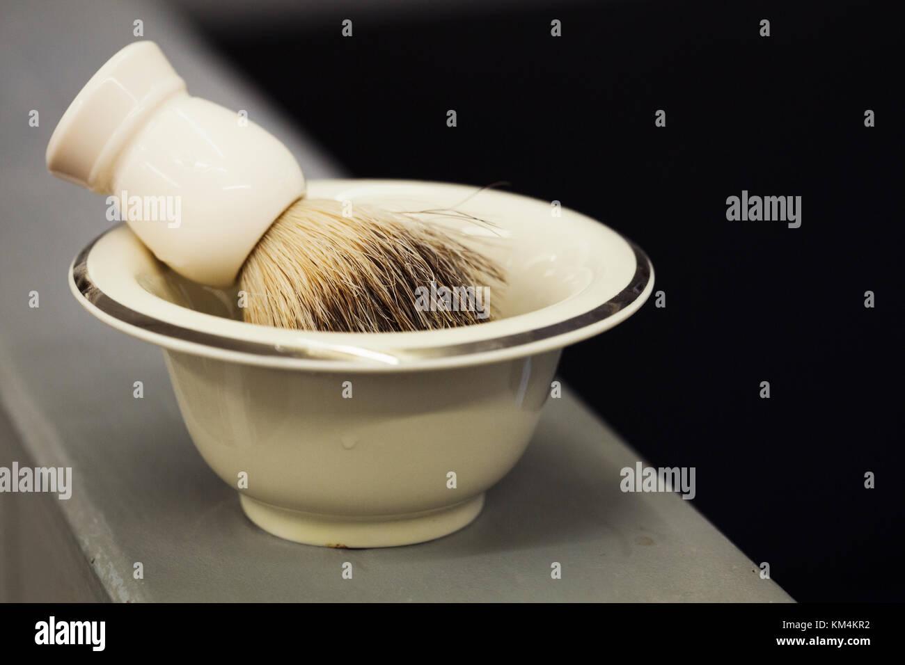 A traditional ceramic shaving bowl and shaving brush. - Stock Image