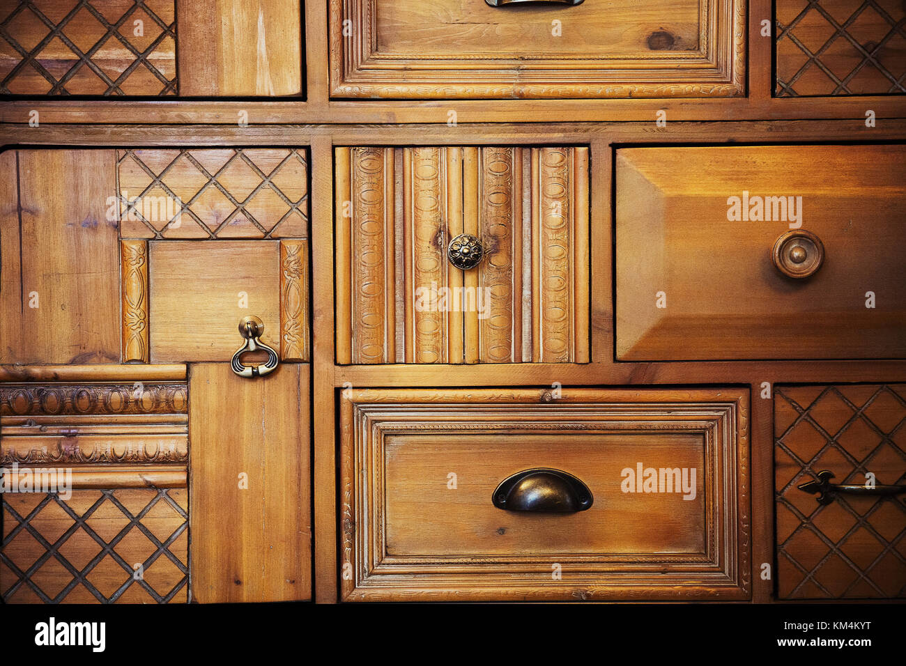 Wooden panels showing different wood finishes, carving, criss cross grooves, marks and handles. - Stock Image