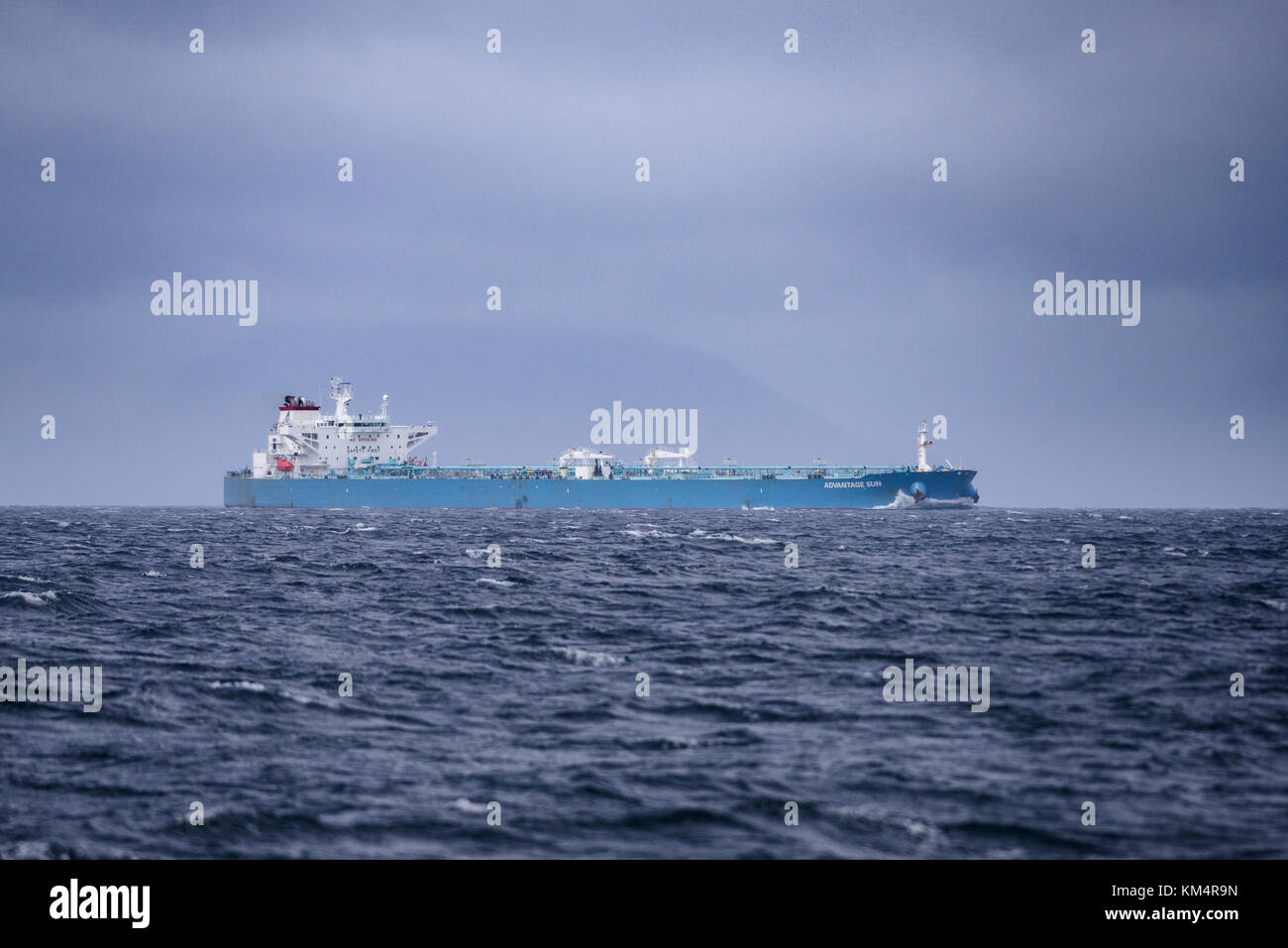 An oil tanker navigating through the Straits of Magellan in southern Chile - Stock Image