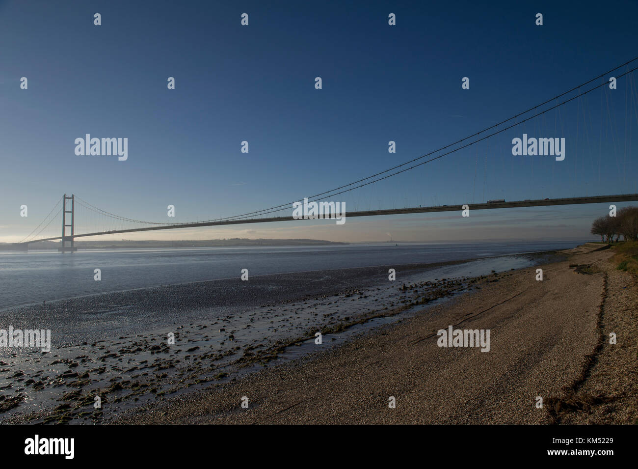 The Humber Bridge near Hull is a single span suspension bridge over the Humber estuary connecting East Yorkshire - Stock Image