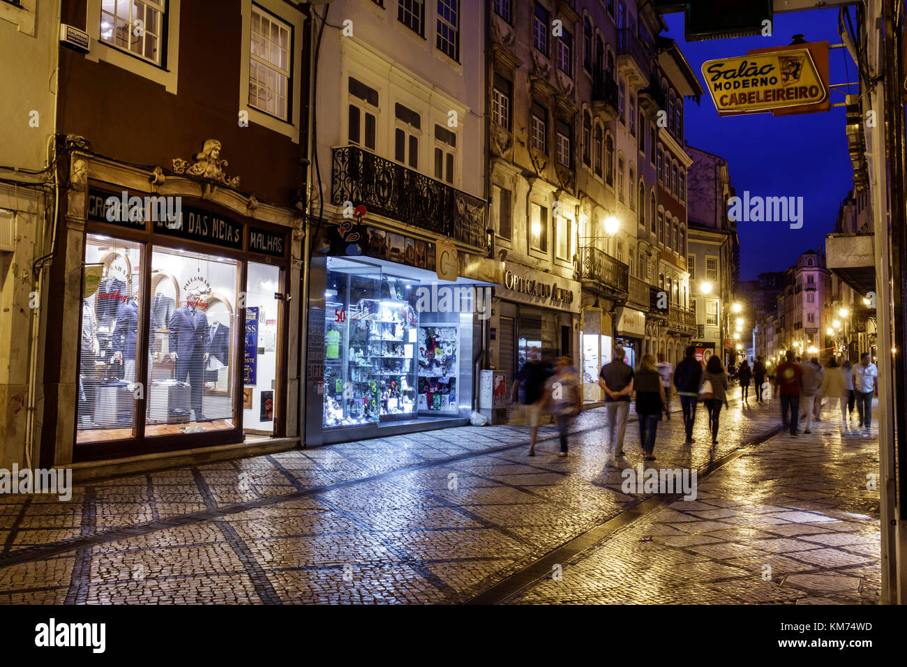 Coimbra Portugal historic center Rua Ferreira Borges business commercial district storefronts shopping pedestrian - Stock Image