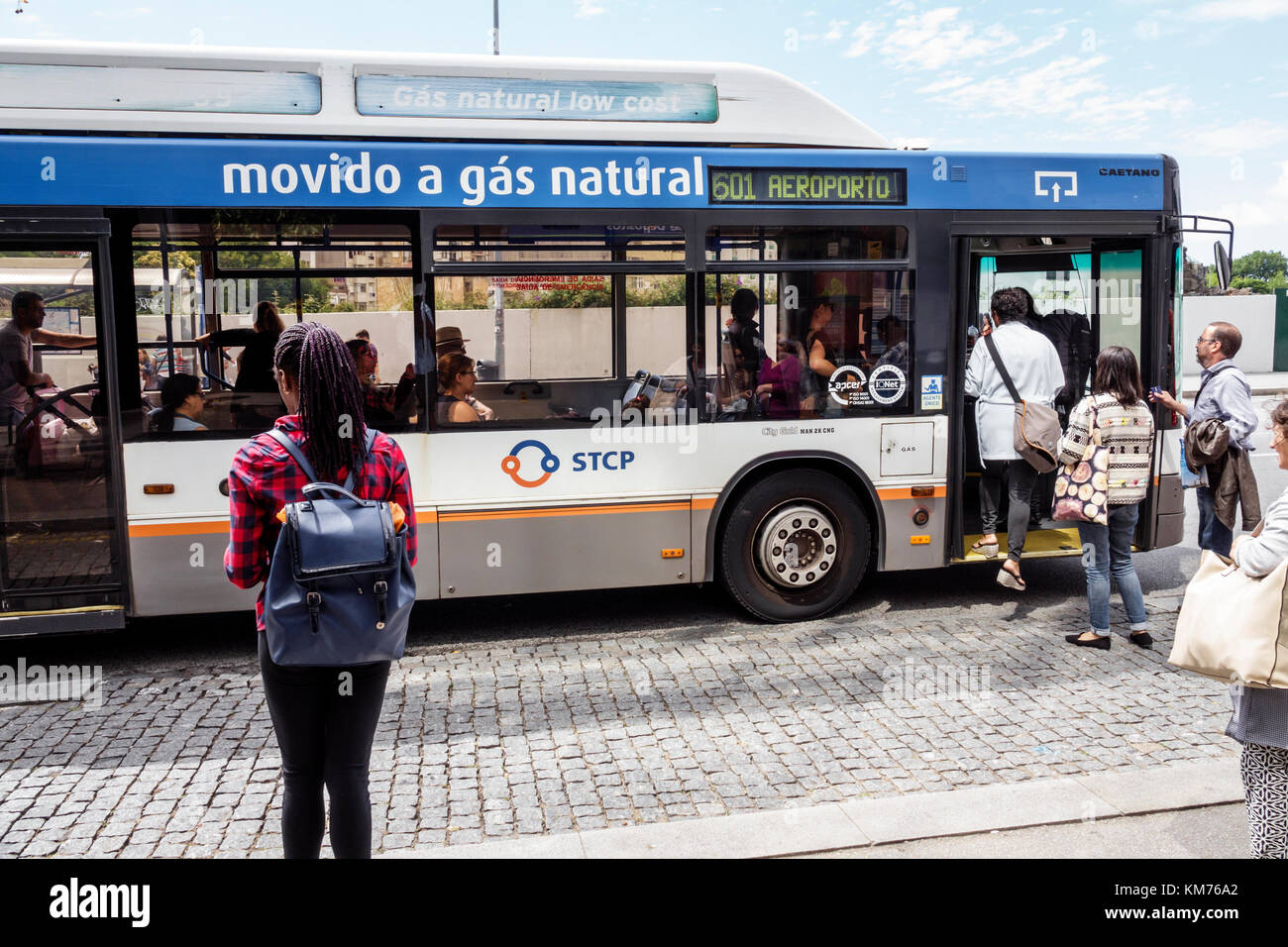 Porto Portugal public transport Porto bus network STCP stop boarding man woman airport express natural gas vehicle - Stock Image